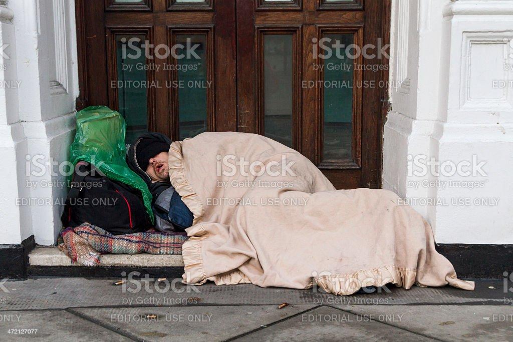 homeless man sleeping rough stock photo