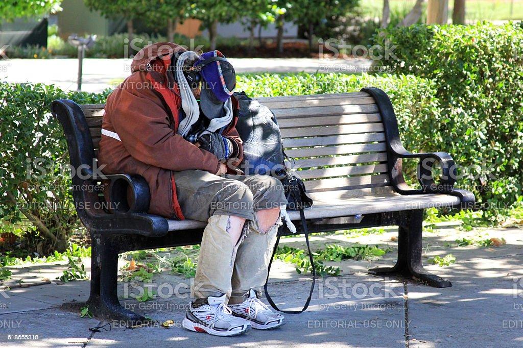 Homeless man sleeps on the street stock photo