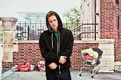 Homeless man standing outdoors