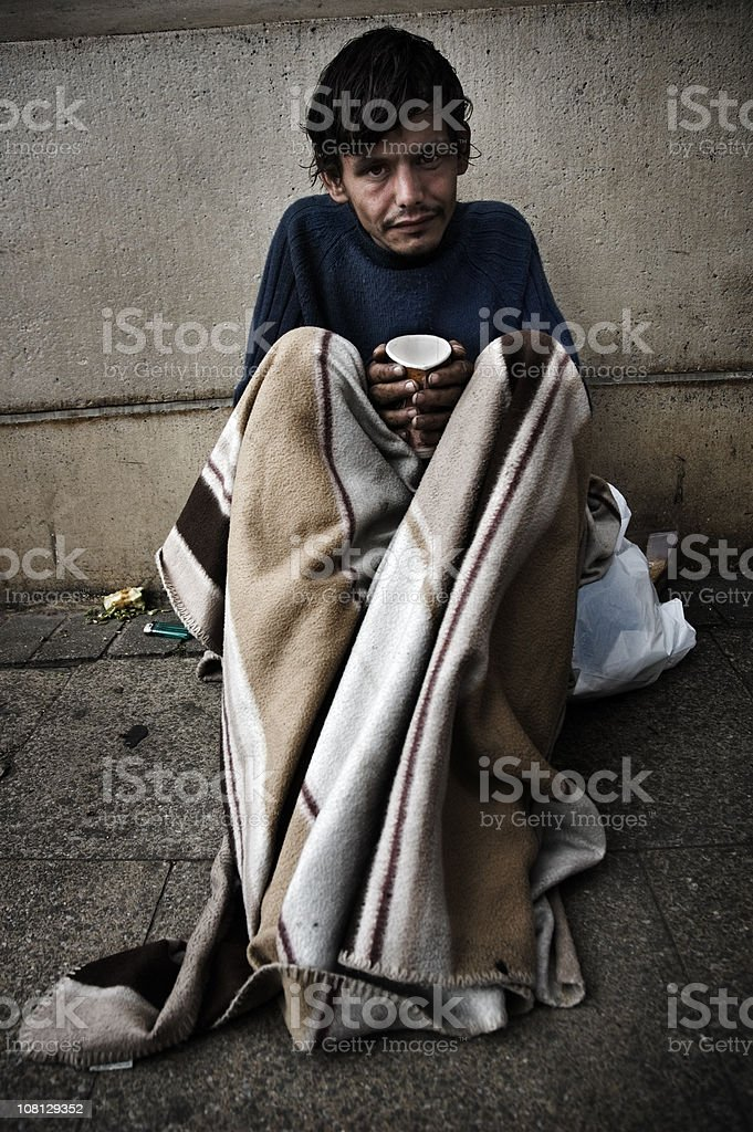 Homeless Man Under Blanket royalty-free stock photo