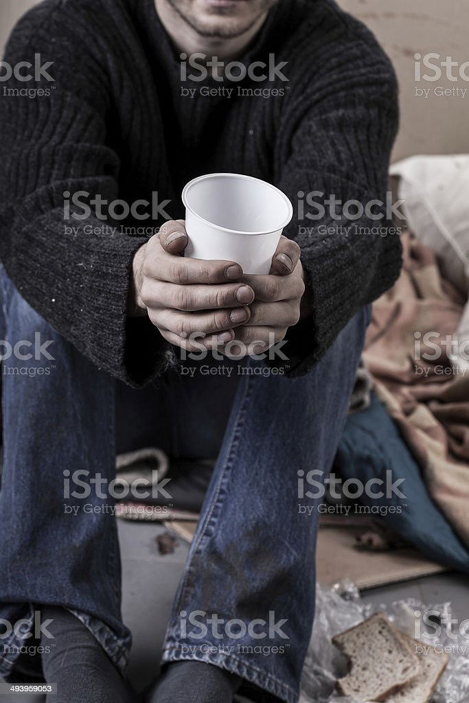 Homeless man waiting for alms royalty-free stock photo