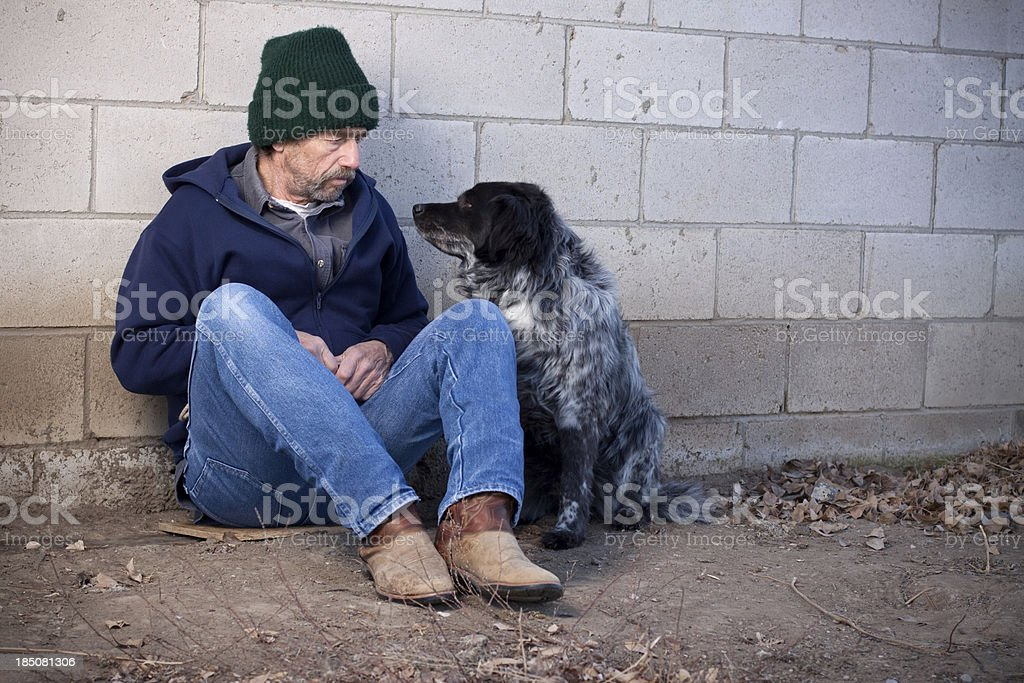 Homeless Man with Dog stock photo