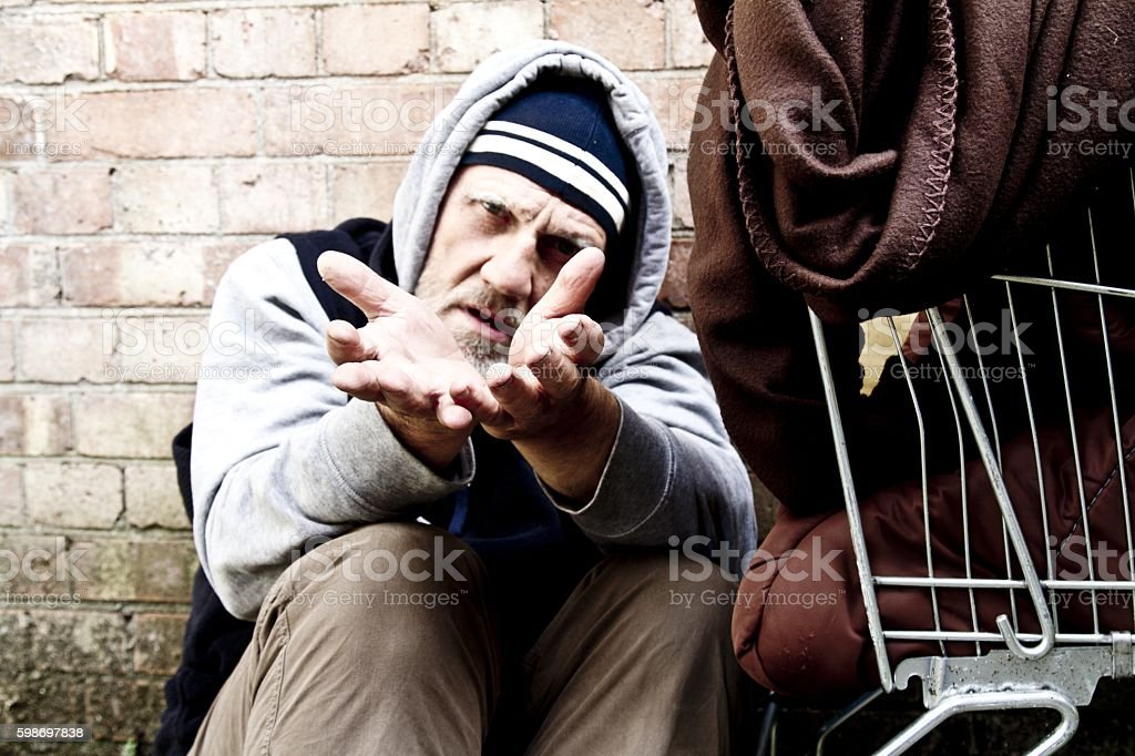 Homeless man with hands outstretched stock photo