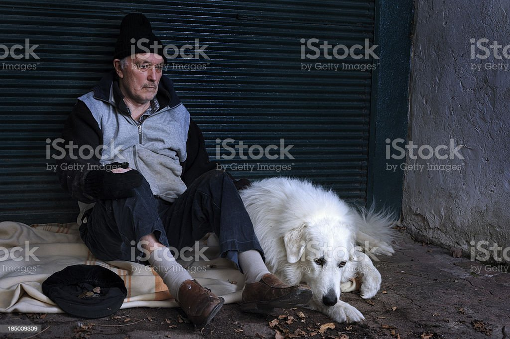 Homeless man with his dog royalty-free stock photo