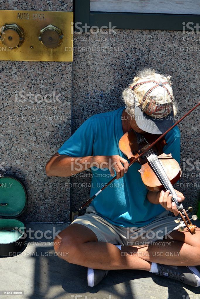 Homeless Man with Musical Instrument Violin royalty-free stock photo