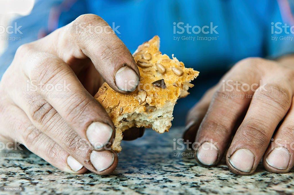 Homeless men holding bread stock photo