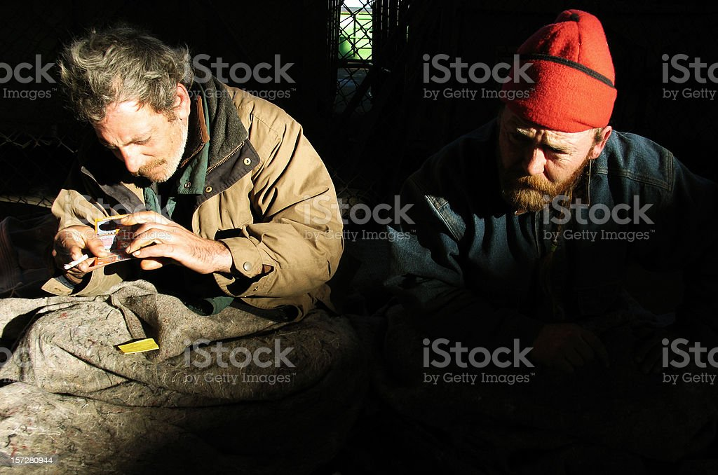 Homeless Men with Lottery Tickets royalty-free stock photo
