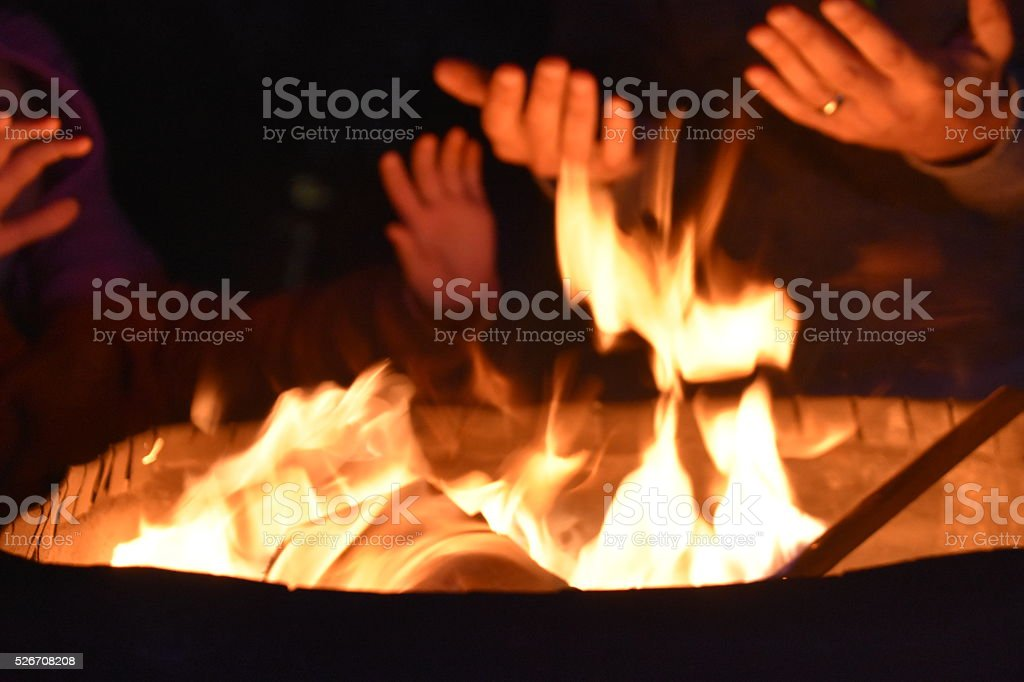 Homeless people warming hands by the  fire stock photo
