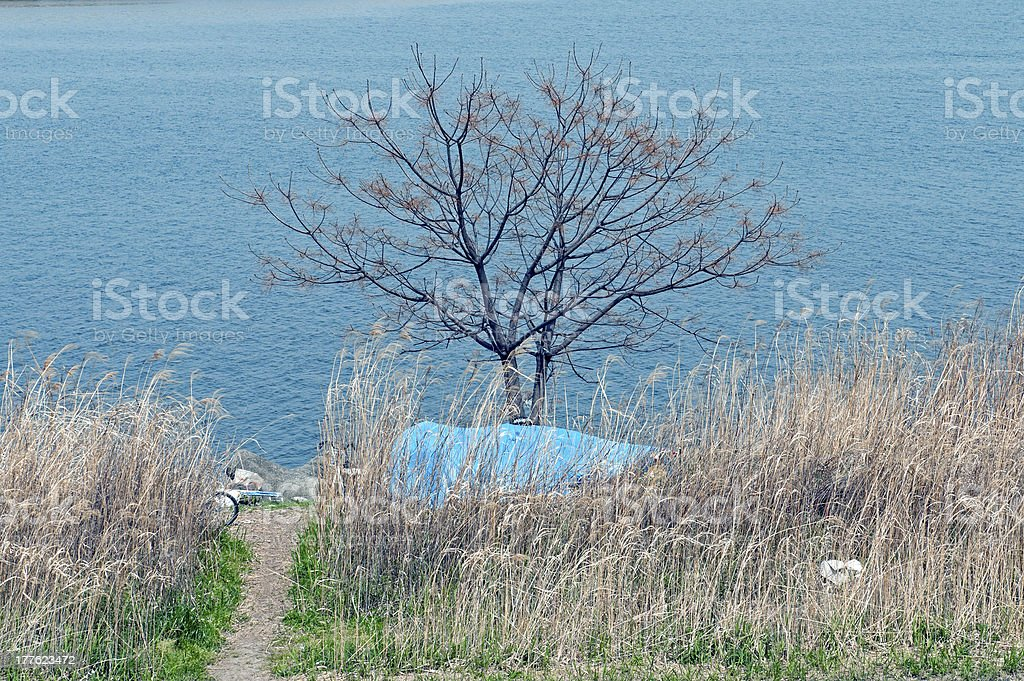 Homeless person's encampment on river in Osaka stock photo