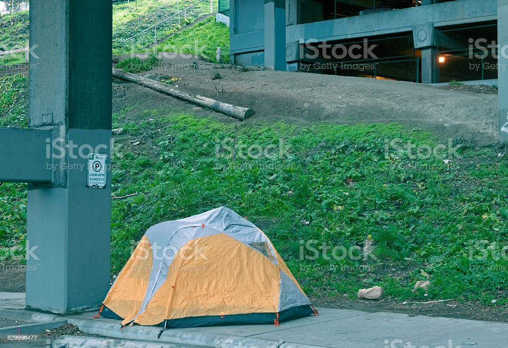 Homeless person's tent below viaduct in Seattle WA stock photo