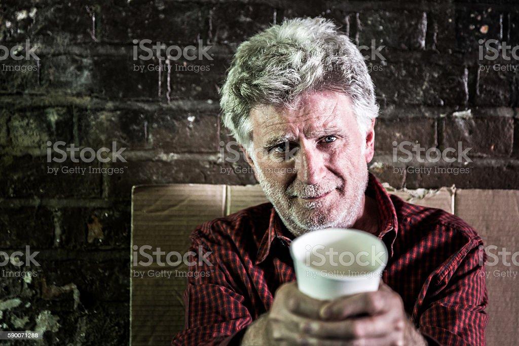 Homeless senior adult man begging for money stock photo