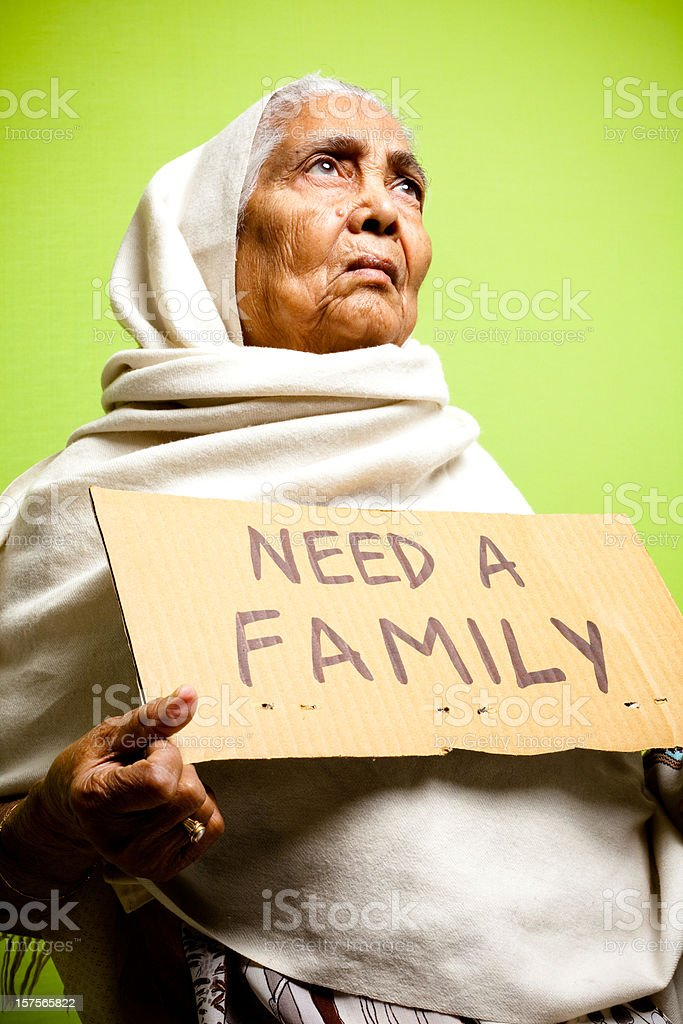 Homeless Senior Indian Woman making an appeal to adopt her royalty-free stock photo