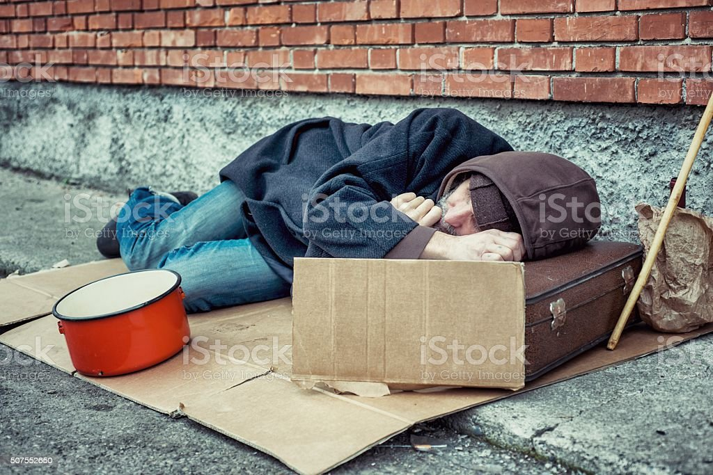 Homeless Sleeping on Sidewalk stock photo