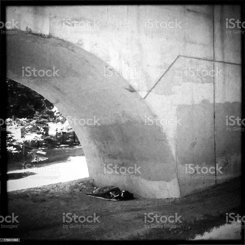 Homeless under a bridge stock photo
