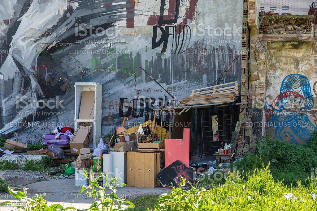 Homeless with graffiti stock photo