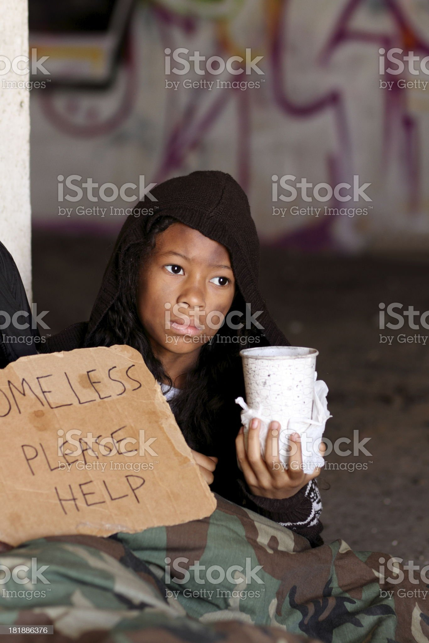 Homeless Young Girl With Cup Vertical royalty-free stock photo