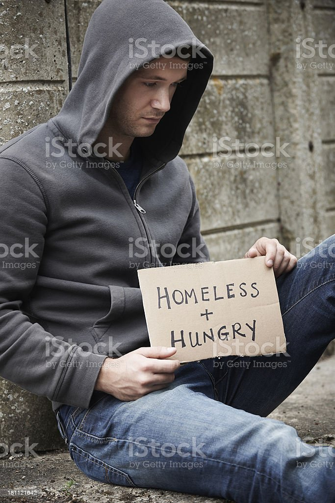 Homeless Young Man Begging On The Street royalty-free stock photo
