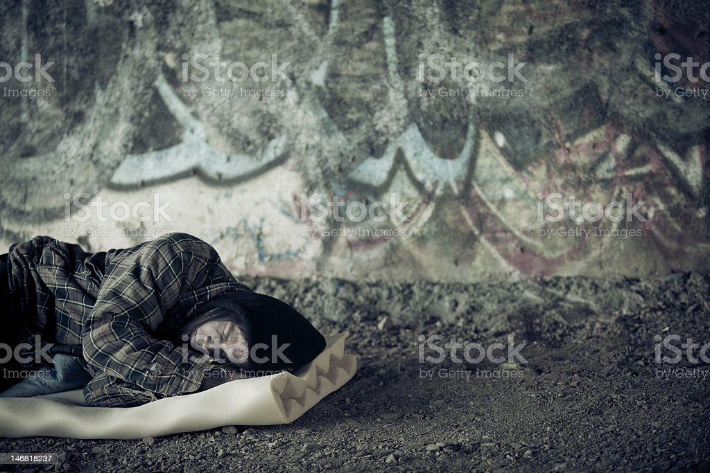 Homeless Young Man Sleeping stock photo