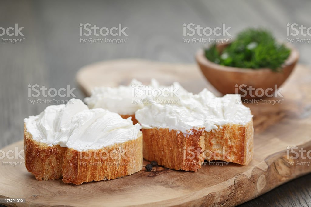 homemade appetizing crostini with soft cheese cream herbs stock photo