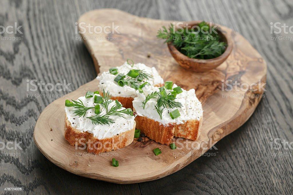 homemade appetizing crostini with soft cheese cream herbs stock photo