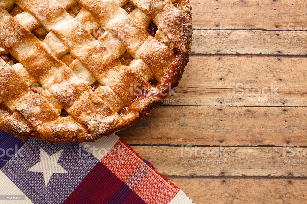 A homemade apple pie on a rustic table setting stock photo