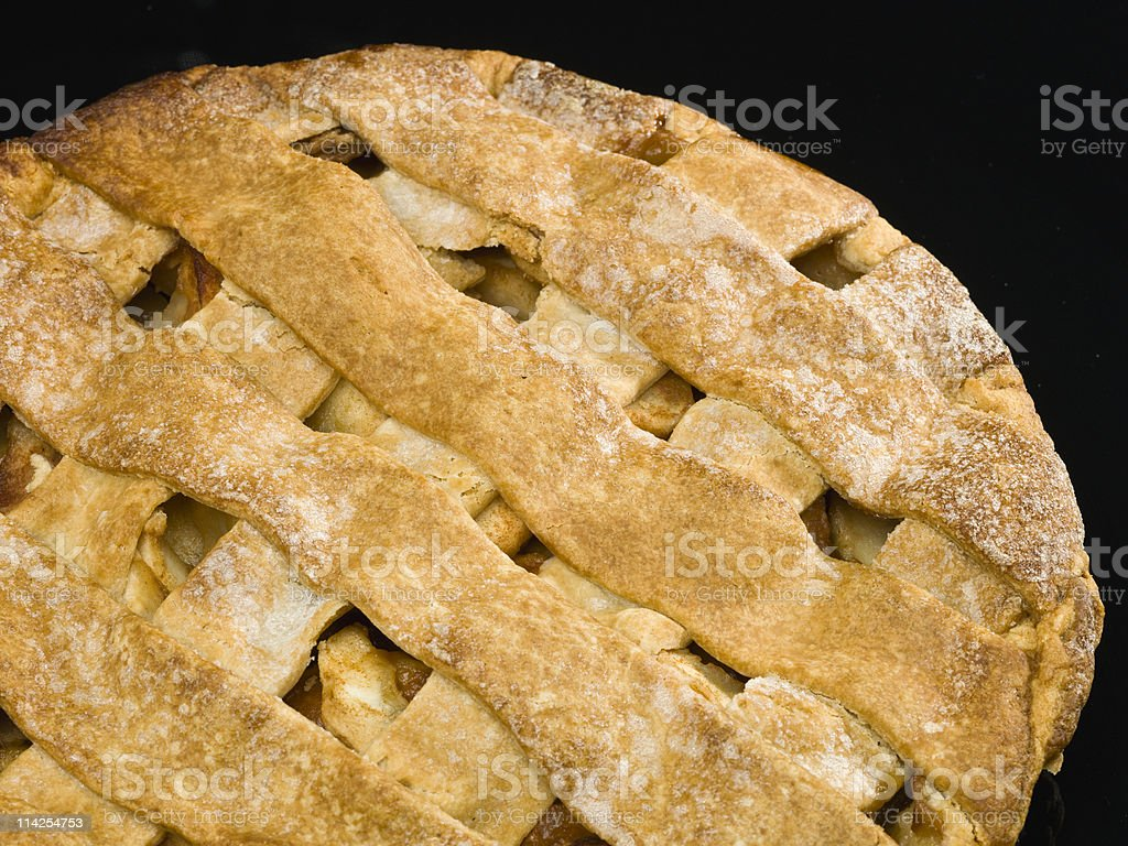 Homemade apple pie with a laced pattern royalty-free stock photo