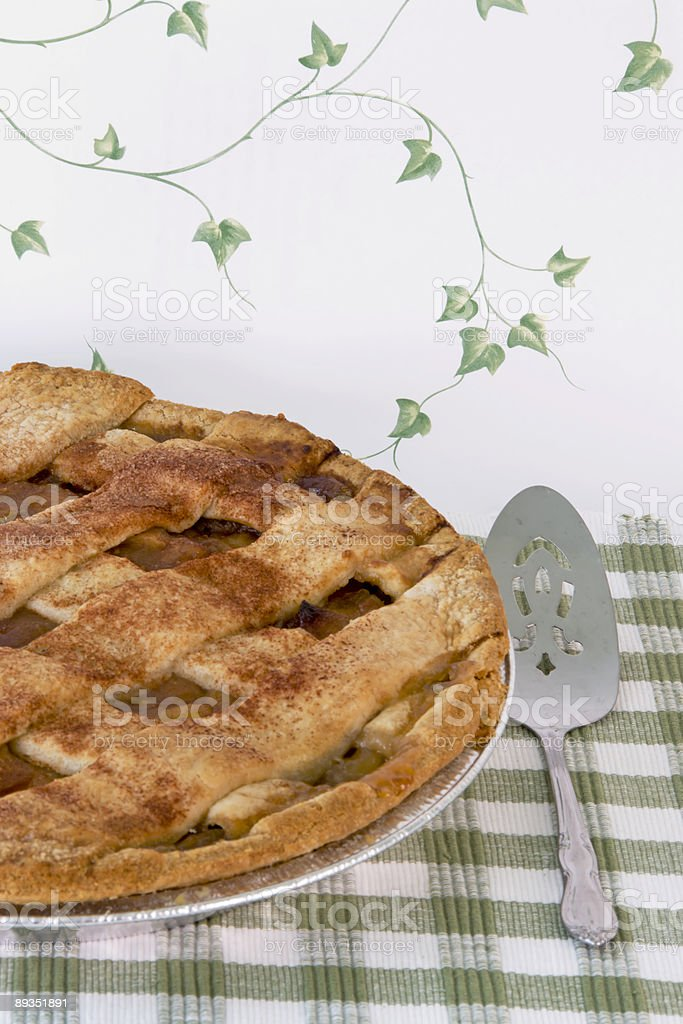 Homemade apple pie with a latticed sugar and cinnamon crust royalty-free stock photo