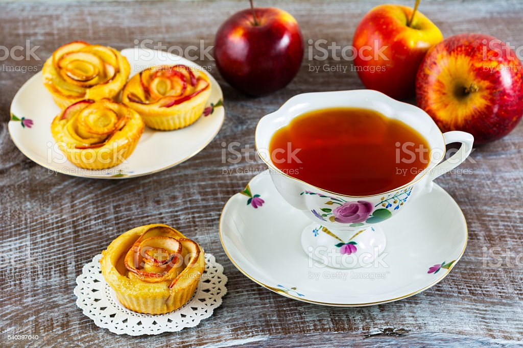 Homemade Apple rose cake and cup of tea stock photo