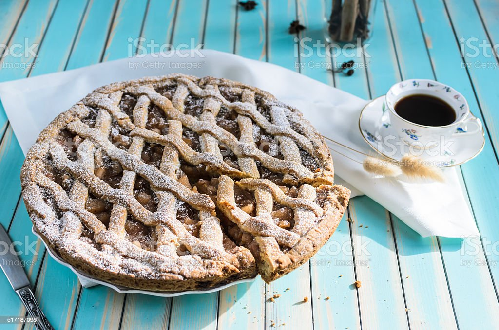 Homemade apple tart pie on dish over wooden turquoise background stock photo