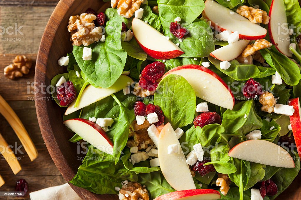 Homemade Autumn Apple Walnut Spinach Salad stock photo