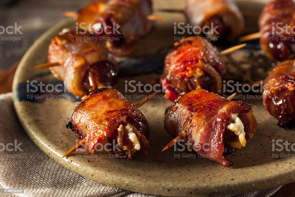 Homemade Bacon Wrapped Dates stock photo