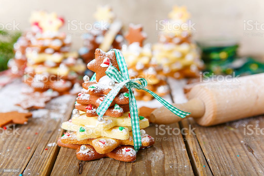 Homemade baked Christmas gingerbread tree on vintage wooden back stock photo