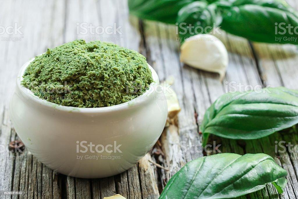 Homemade basil Pesto, selective focus stock photo