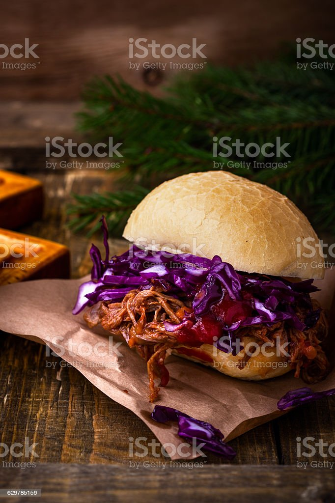 Homemade bbq beef burger with crunchy red cabbage slaw stock photo