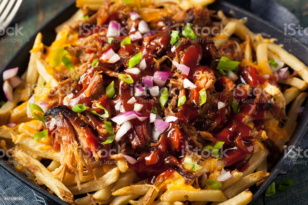 Homemade BBQ Pulled Pork French Fries stock photo
