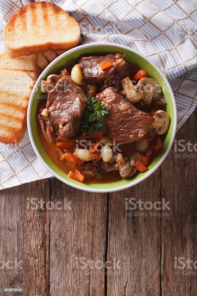 Homemade Beef Bourguignon in bowl. vertical top view stock photo