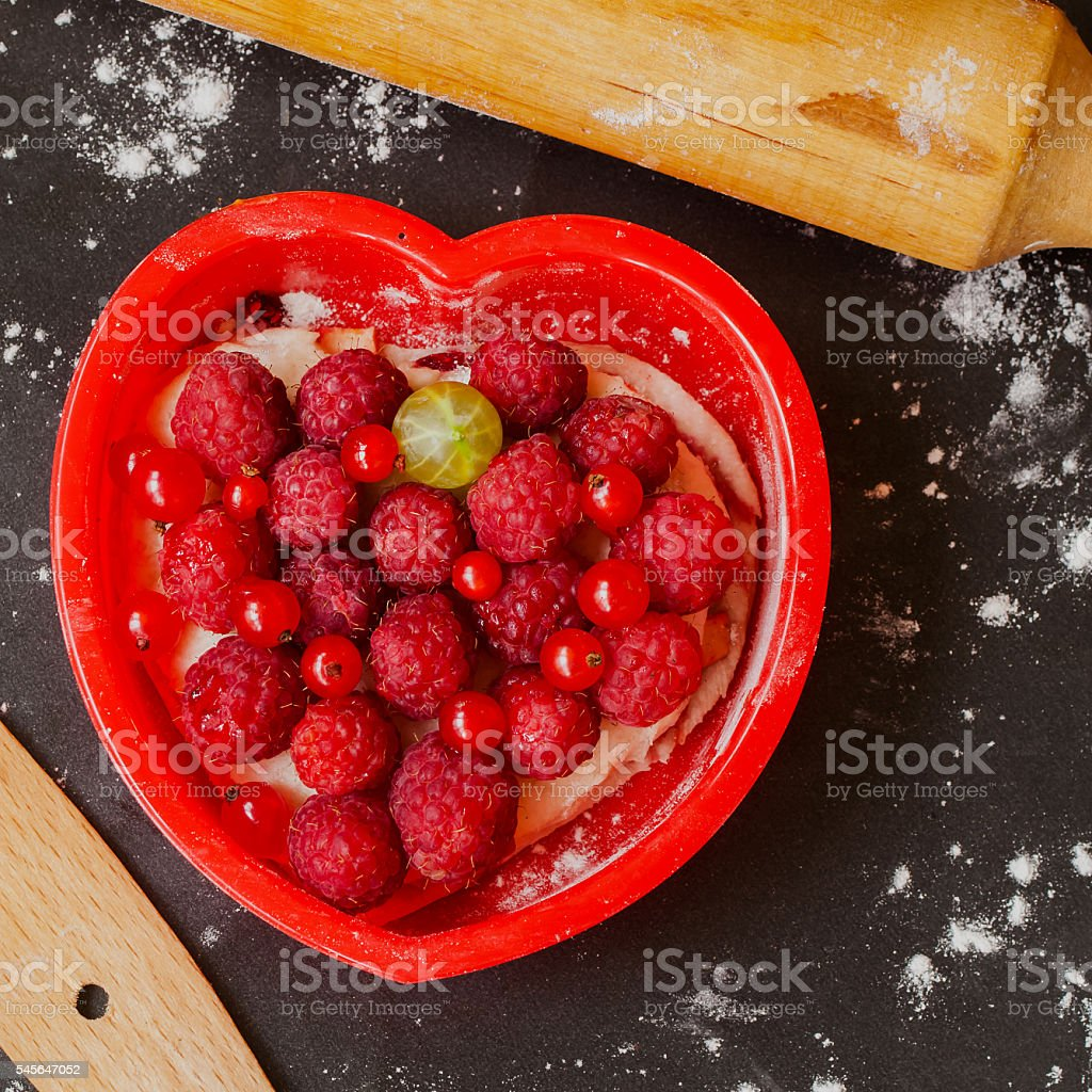 Homemade berries pie with red heart shaped stock photo