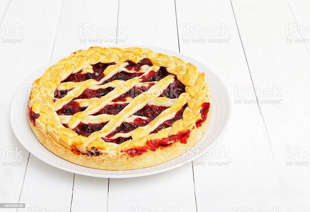 Homemade berry pie with cherries and raspberries stock photo