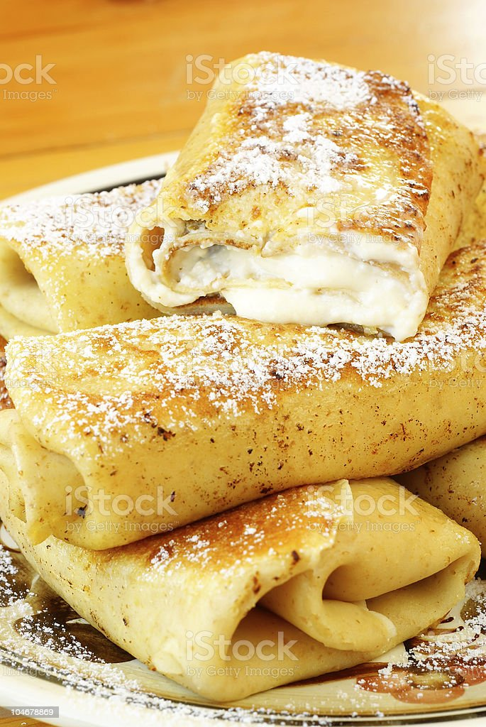 Home-made blintzes topped with powdered sugar royalty-free stock photo