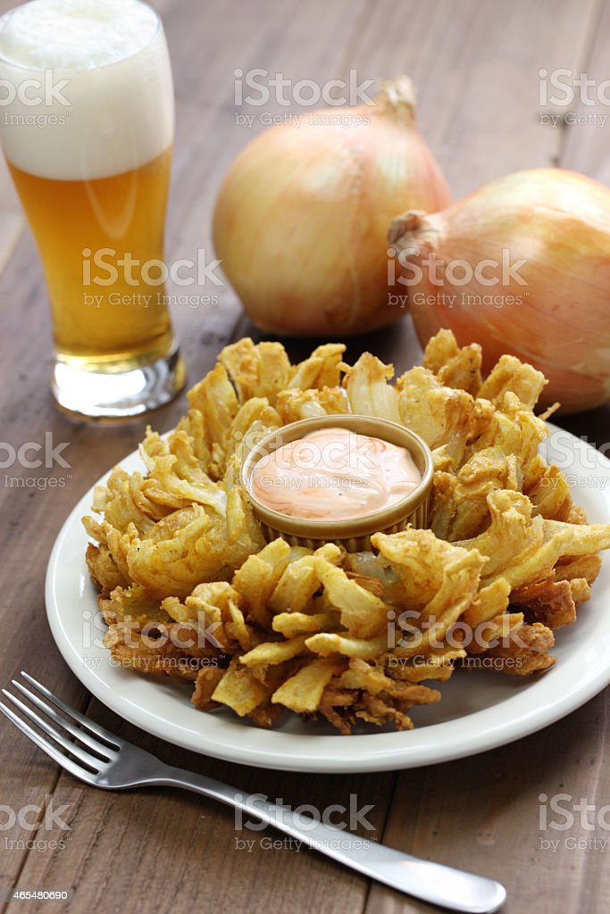 Homemade blocking onion with dip complemented with beer stock photo