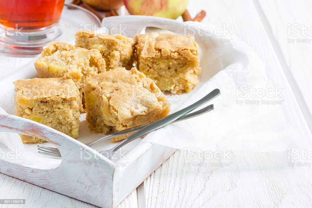 Homemade blondie brownies apple cake, square slices, copy space stock photo
