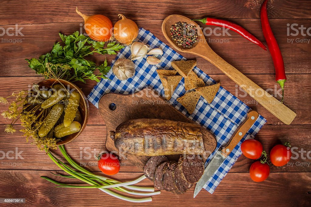 Homemade blood sausage with offal on the old wooden background stock photo