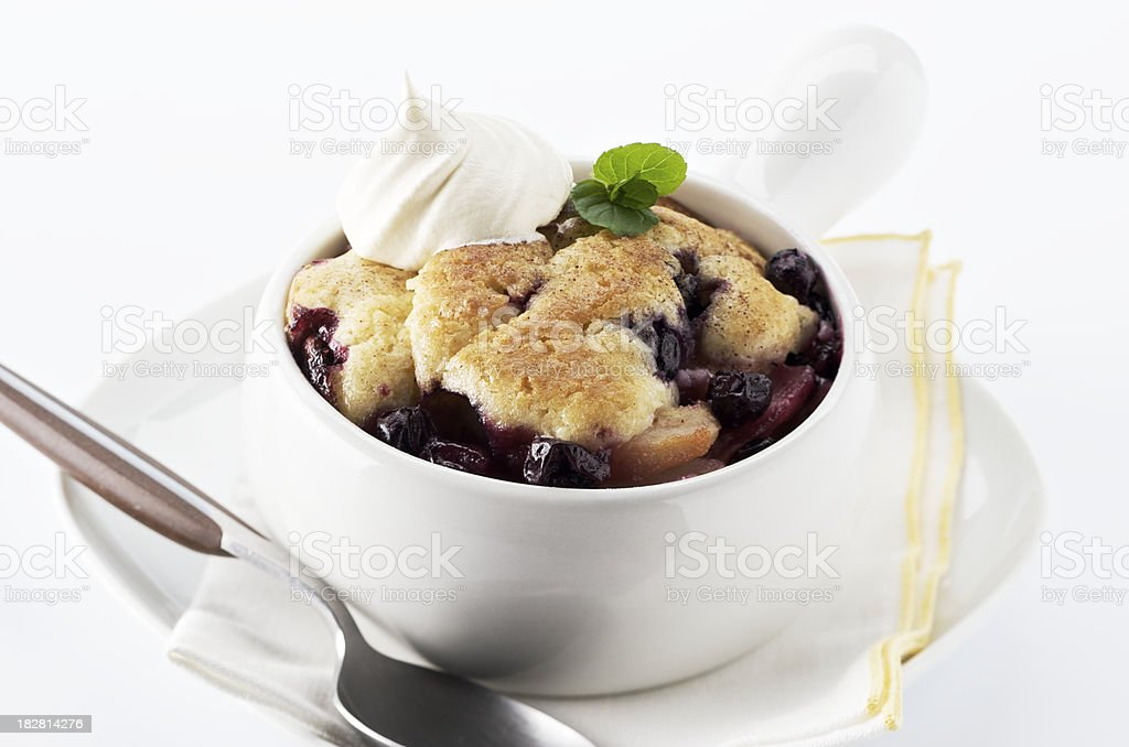 Homemade blueberry cobbler in a white bowl royalty-free stock photo