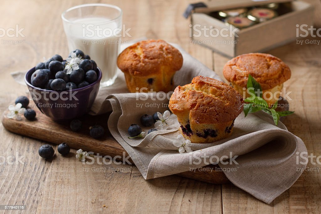 Homemade blueberry muffins with glass of milk stock photo