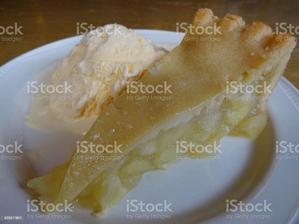 Homemade Bramley apple pie / ice cream dessert, apple tart slice stock photo