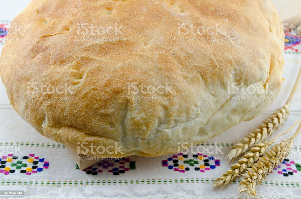 Homemade bread on a vintage tablecloth royalty-free stock photo