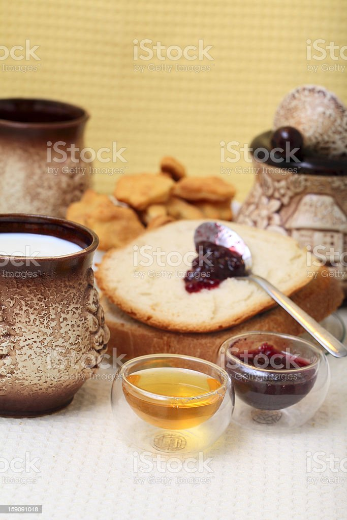 Homemade bread with redberries jam and honey royalty-free stock photo