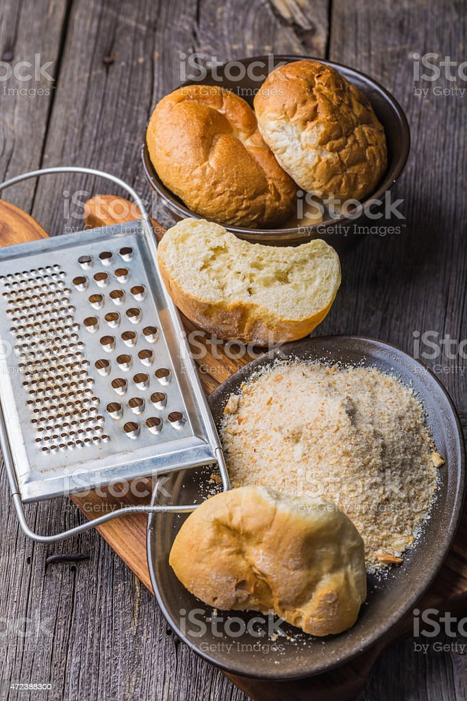 Homemade breadcrumbs on a wooden table stock photo