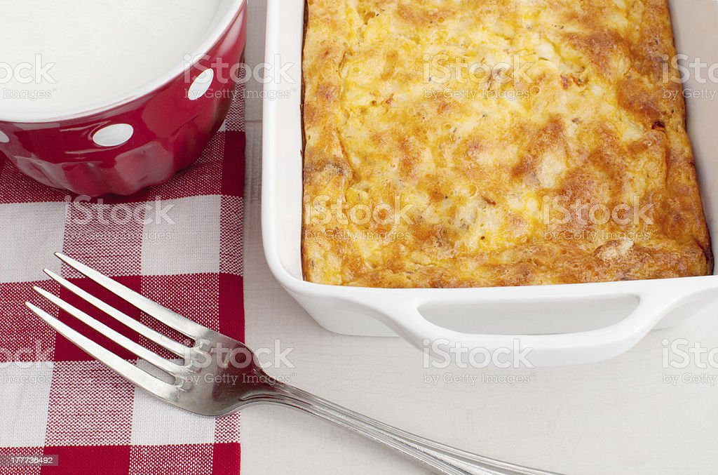 Homemade breakfast casserole with cup of milk stock photo