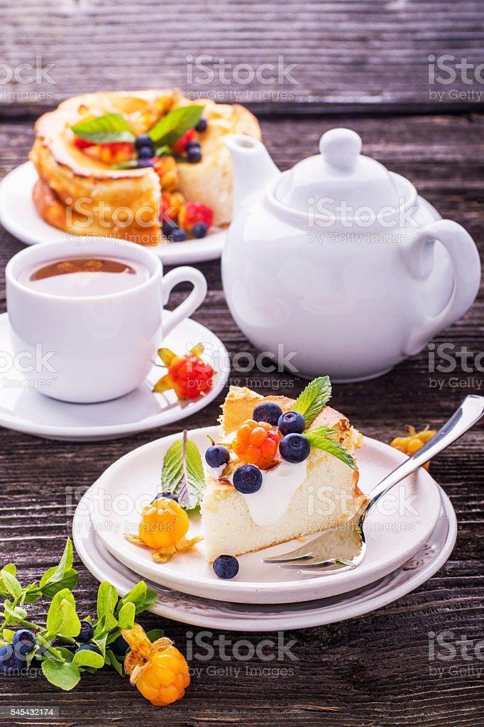 Homemade breakfast. Fresh cheesecake with Nordic berries cloudberries and blueberries stock photo